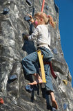 Rock climbing girl with face painting royalty free stock photography