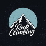 Rock Climbing hand written lettering with mountains. Royalty Free Stock Photos