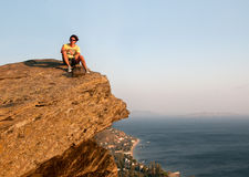 Man Sitting on Rock Royalty Free Stock Photo