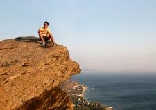 Man Sitting on Rock royalty free stock photo