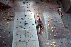 Rock Climbing. An image of people rock climbing at an indoor gym stock images