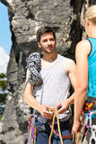 Rock climbing man showing woman rope knot Royalty Free Stock Photo