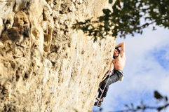 Rock climbing move. Young male is making a hard move when climbing a hard route in Crimea, Ukraine Royalty Free Stock Photos