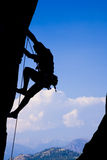 Rock climbing an overhanging face Royalty Free Stock Photos
