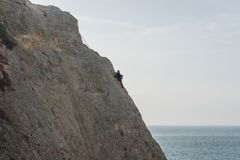 Rock climbing at Point Dume in winter, Malibu, California. Rock climbing at Point Dume in winter, Malibu, Southern California Stock Images
