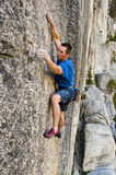 Rock climbing a sheer face. Royalty Free Stock Photo