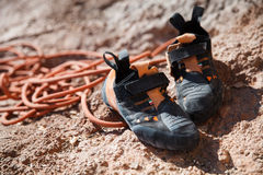 Rock climbing shoes over belay rope closeup Royalty Free Stock Images