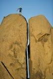 Rock climbing a split pillar. Stock Image