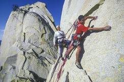 Rock climbing team. Team of climbers struggle to the summit of a challenging cliff Royalty Free Stock Photography