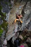 Rock climbing team on a challenging ascent. Climber and belayer. Stock Photo