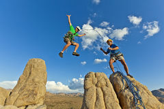 Rock climbing team reaching the summit. Royalty Free Stock Photos