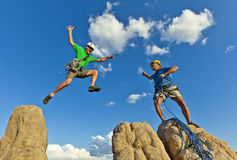 Rock climbing team reaching the summit. Royalty Free Stock Images