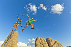 Rock climbing team reaching the summit. royalty free stock photo