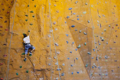 Rock-climbing teenager Stock Photos