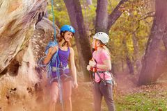 Free Rock Climbing Trainer And Girl In Special Outfit Stock Image - 109868131