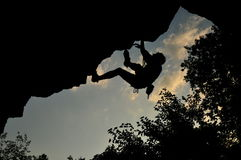 Rock climbing in Ukraine. Young male is climbing a hard route in Kamianiets-Podilskii, Ukraine Royalty Free Stock Photography