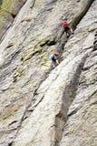 Rock climbing on a wall. Stock Photos