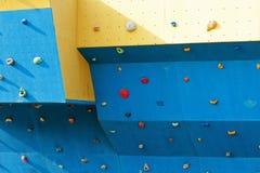 Rock climbing wall. Blue Rock climbing wall background royalty free stock photos