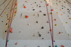 Rock climbing wall Stock Images