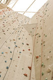Rock climbing wall with ropes Stock Image