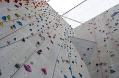 Rock climbing wall with ropes Stock Photo