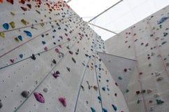 Rock climbing wall with ropes. Rock climbing wall, Edinburgh International Climbing Arena, Ratho Stock Photo