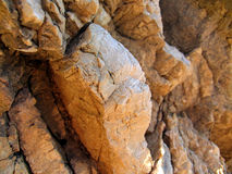 Rock closeup. Rock on bright sunlight closeup Royalty Free Stock Photo