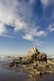 The rock and the cloud. Rock and cloud in a seashore scene Stock Photography