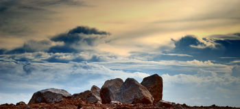 Rock with cloud background Stock Images
