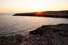 Rock coast of Lampedusa. Rock coast of  Lampedusa at sunset, Sicily stock photo