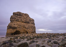 Rock on the Coast. A large rock formation on a beach in the northeast of England, UK stock image
