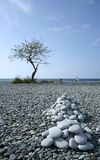 Rock collectors pebble beach philippines Stock Photos