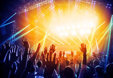 Rock concert. Photo of young people having fun at rock concert, active lifestyle, fans applauding to famous music band, nightlife, dj on the stage in the club Royalty Free Stock Image