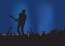 Rock concert. Illustration of a silhouette of young guitarist on the stage playing guitar in front of audience Royalty Free Stock Photos