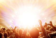 Rock concert. Active happy people enjoying rock concert, many lights from the stage where playing famous musical band, night entertainment concept royalty free stock photography
