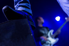 Rock concert background. Rock concert stage background, blue color, guitarist and shoes framing royalty free stock photography