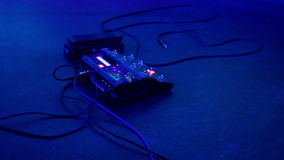 Rock concert backstage: the foot controller on stage stock video footage
