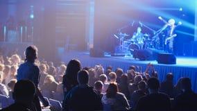 Rock concert - crowd in auditorium listening performance stock image