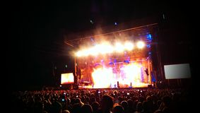 Rock concert. The crowd gathered in front of a stage in a rock concert Stock Image