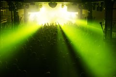 Rock concert crowd. People in front of the bright stage lights royalty free stock photography
