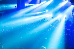 Rock concert crowd. People in front of the bright stage lights Royalty Free Stock Image