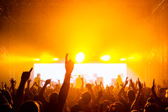Rock concert. Happy people silhouettes Stock Photos