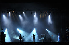 Rock concert live. On stage outside silhouette of singers on stage Royalty Free Stock Images