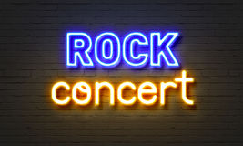 Rock concert neon sign on brick wall background. Stock Image