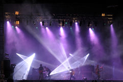 Rock concert. On stage outside silhouette of singers on stage stock photo