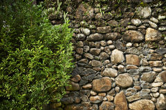 Rock and Concrete Wall Royalty Free Stock Images