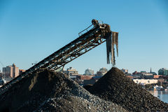 Rock conveyor. A conveyor in a city gravel plant piles rock and gravel for use in construction work Stock Photos