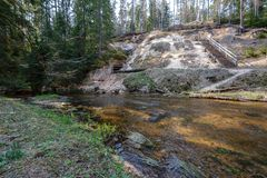 Rock covered river bed in forest with low water level. And tree roots on the ground. shores of sandstone and rocks stock photos