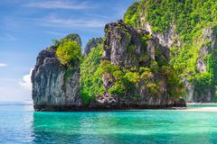 Rock covered with trees in the Andaman Sea on the island of Hong. Thailand royalty free stock photo
