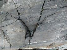 Rock cracks with water stuck Royalty Free Stock Photo